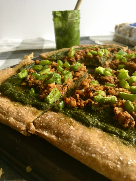This vegan pizza is THE BEST! Rustic wheat crust, flavorful pesto, and smoky walnut sausage. It's easy to make and VERY fun to eat! // Recipe from plantpowercouple.com