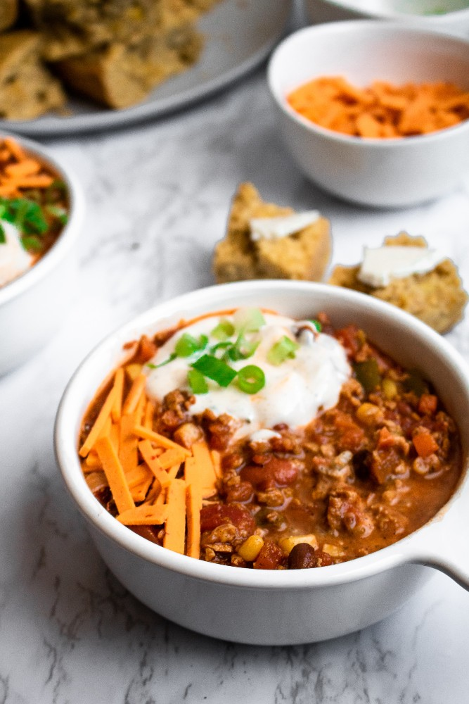 Simple vegan chili recipe, made with TVP, is warm and cozy like a bowl full of hugs! It's a super easy and hands-off recipe that is perfect for meal prep or a busy weeknight dinner. Add everything to one pot and let it simmer. #vegan #veganchili #chili #plantbased // plantpowercouple.com