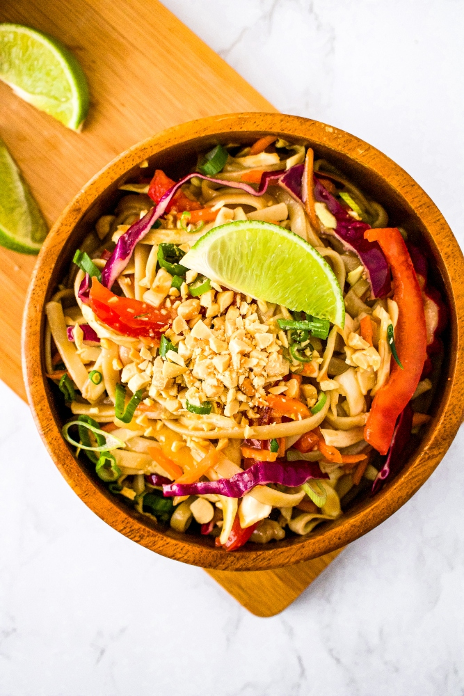 This simple vegan cold noodle salad with peanut sauce is an easy vegetarian and dairy-free lunch recipe that can be made ahead and only takes about 15 minutes to make. Peanut Lime Noodle Salad is the perfect recipe for a stunning but simple outdoor lunch - especially at the end of summer when it's so hot you just want something light, refreshing, easy, and healthy! This chilled noodle dish is completely plant-based and also easy to make oil-free and gluten-free.