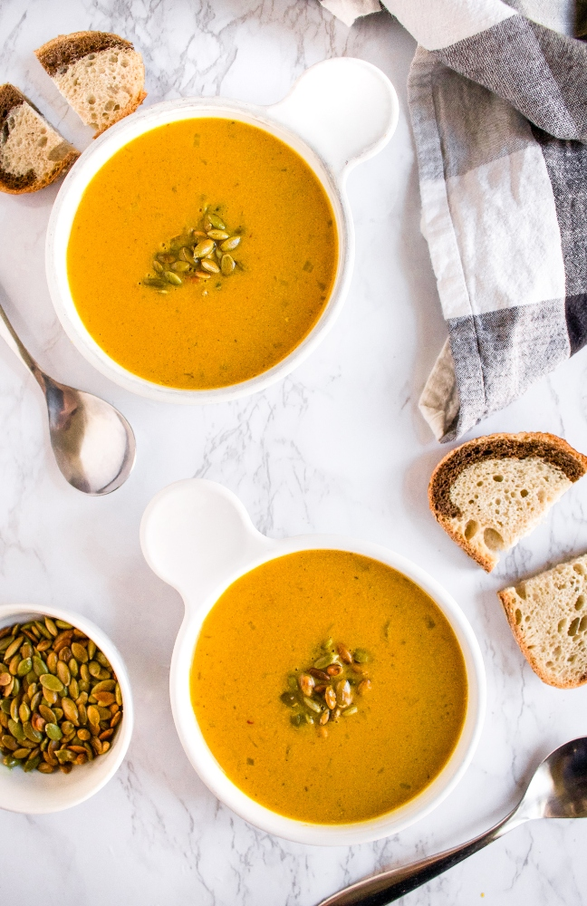 This savory curried pumpkin soup is an easy one-pot plant-based meal. Make it on the stove or in the slow-cooker with either canned pumpkin or fresh pumpkin and a few kitchen staples. It's gluten-free, dairy-free (without coconut milk!), and includes an oil-free option. #vegan #pumpkinsoup #savorypumpkinrecipe