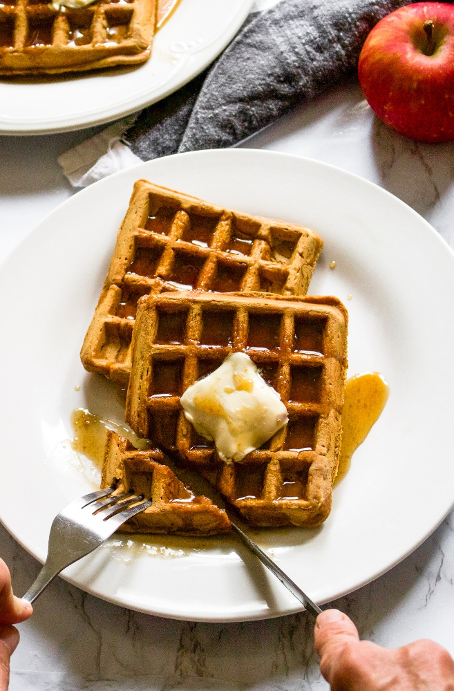 These vegan apple cider waffles with ginger snap syrup are a fun fall breakfast recipe without any butter, milk, or eggs! It's an easy way to use up extra apple cider and apple sauce. Plus, they can even be made into apple cider pancakes if you don't have a waffle maker. Store them in the freezer and reheat them in the toaster for easy comfort food breakfast or snack on the go. #applecider #applerecipe #waffles #veganwaffles #fallbreakfast #veganbreakfast #dairyfreebreakfast