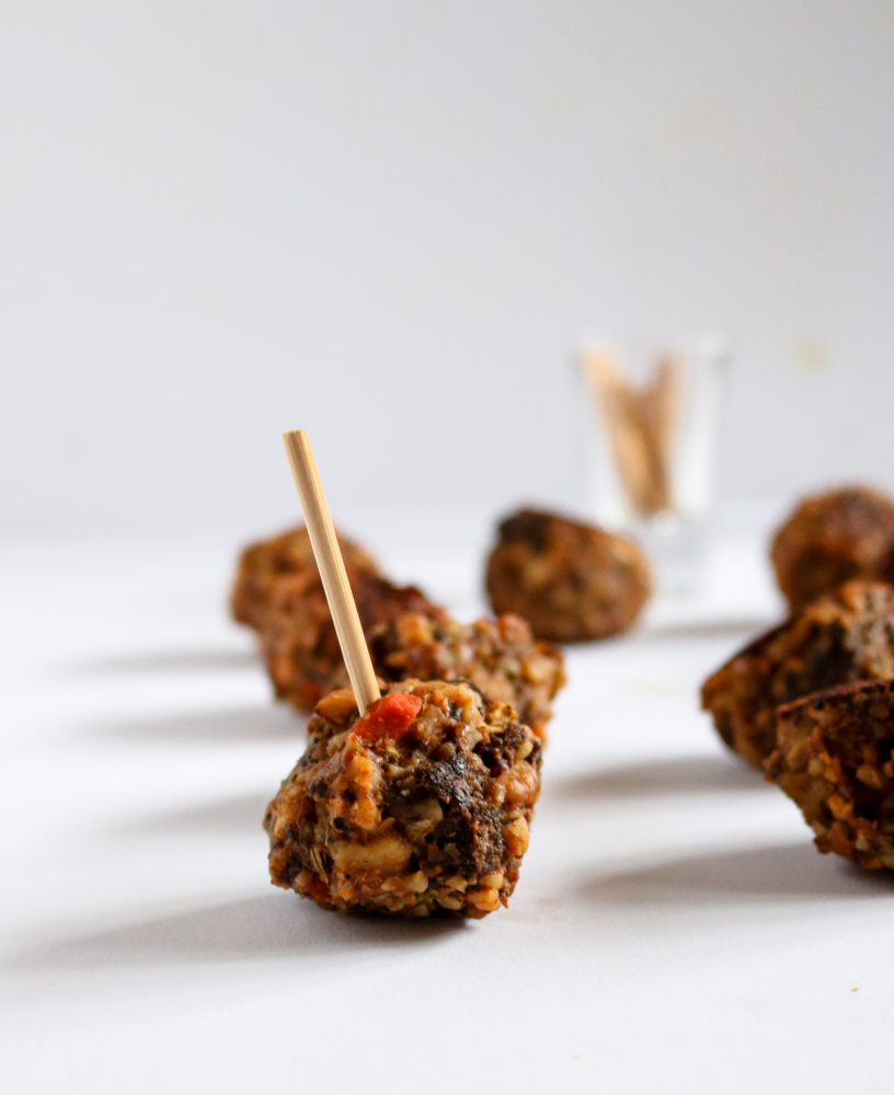 These vegan walnut sausage and stuffing balls are a great way to use up leftover stuffing and a perfect holiday appetizer! They're so full of flavor! // #vegan #appetizer #thanksgiving #stuffing #vegetarian plantpowercouple.com