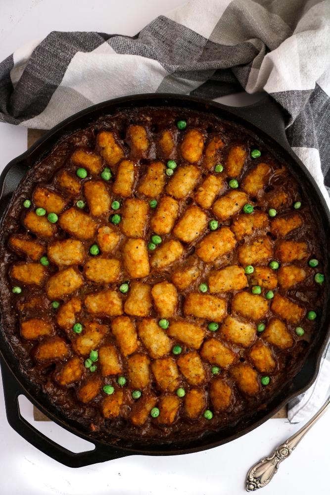 Spicy Vegan Tater Tot Hotdish - a comfort classic made vegan and oh so delicious! #vegan #veganrecipe #hotdish #vegetables #tatertots // plantpowercouple.com