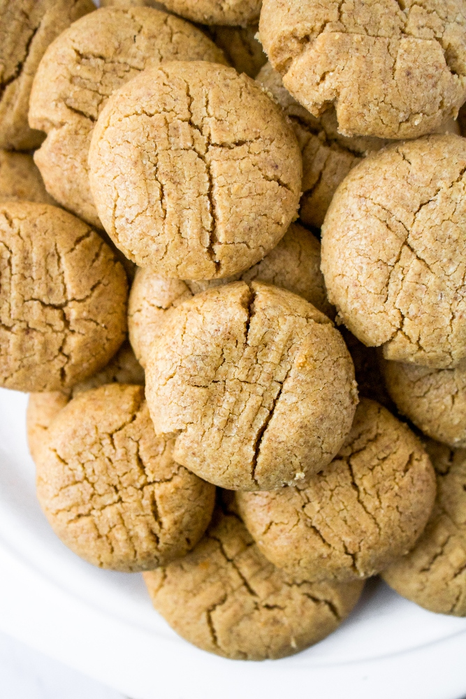 These vegan peanut butter cookies are made dairy-free and egg-free simply by using a flax egg! The decadent vegan cookies are beautifully crumbly and will legit melt in your mouth. They are easy to make - the perfect vegan peanut butter recipe for the holidays or any time of year!