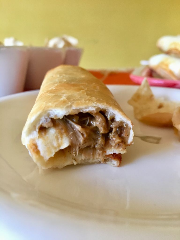 Vegan Taquitos! Make them in the air fryer or deep fryer. They're filled with spicy jackfruit meat and a killer dairy-free queso sauce. // plantpowercouple.com