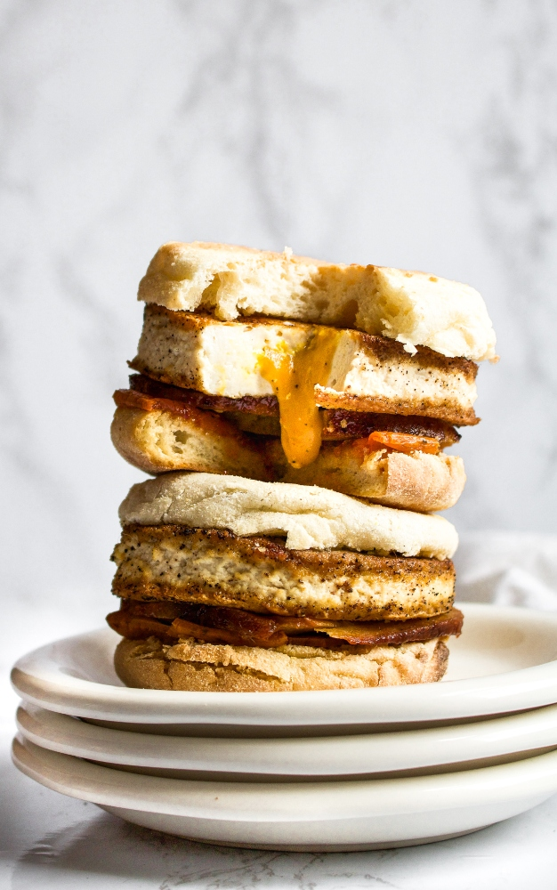 This vegan fried egg is such a fun and delicious recipe. It has a goopy vegan yolk sauce that drips out of the egg when you bite into it - just perfect for toast dipping or a messy fried egg breakfast sandwich. #tofu #veganegg #veganeggyolk #veganfriedegg #veganbreakfast #veganbreakfastsandwich #tofuegg #tofufriedegg #veganbrunch #comfortfood