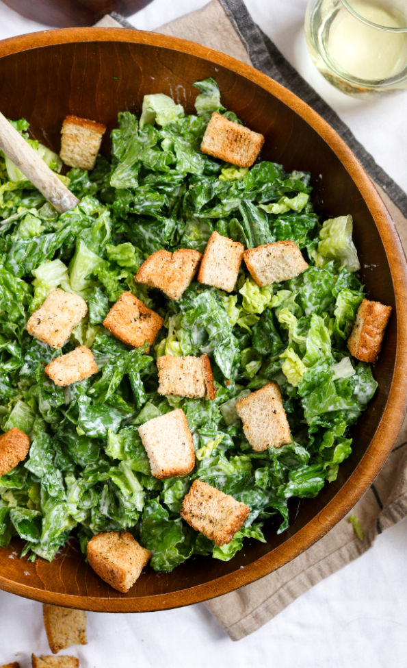 This easy vegan caesar salad recipe is delicious, nut-free, and meal prep friendly! The dressing is made with a silken tofu base and flavored to perfection with only 9 simple ingredients. #vegan #caesarsalad #veganrecipe #mealprep #salad // plantpowercouple.com