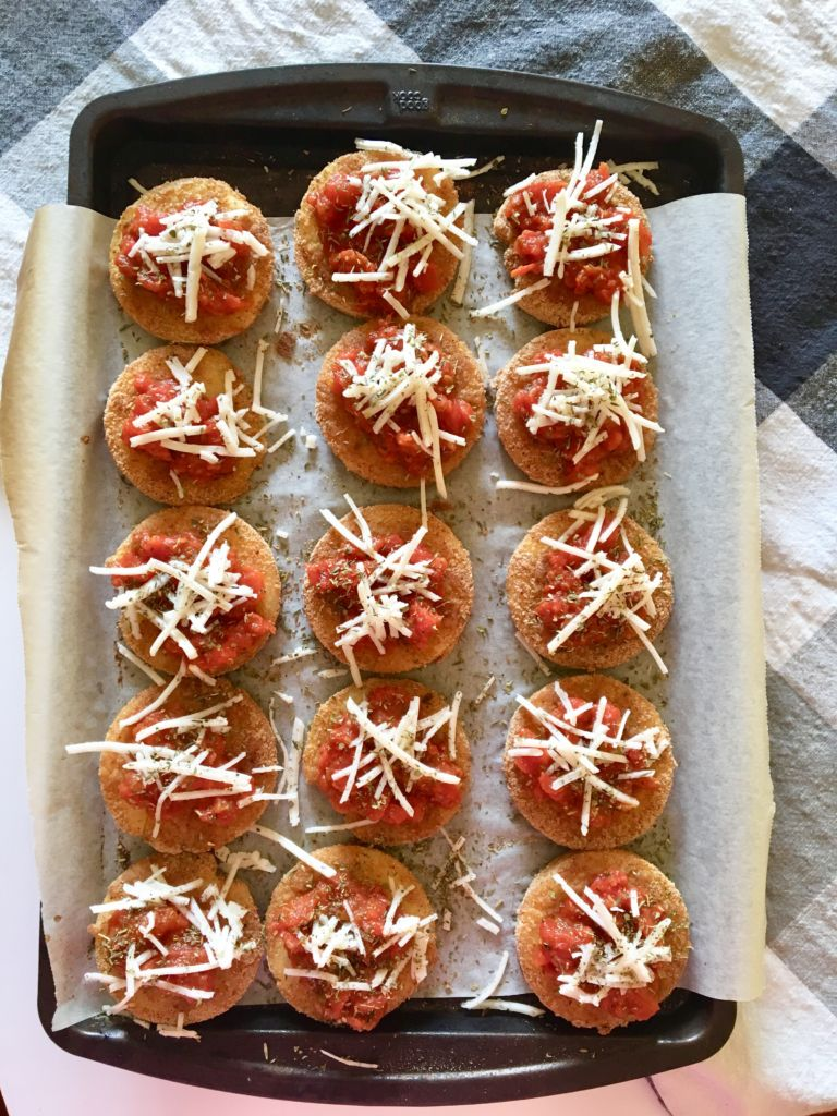 Polenta Pizza Bites - an easy, vegan recipe that's a total crowd favorite and perfect for potlucks or family gatherings! They come together SO quickly. This was one of the first recipes I made when I went vegan! // plantpowercouple.com