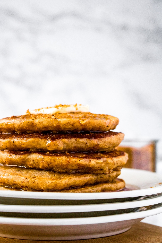 Coconut Bacon Pancakes are the BEST fluffy vegan pancake recipe. Dairy-free pancakes are easy to make from scratch! The plant-based bacon in this recipe creates the perfect blend of sweet and savory flavors, but it's also easily customized! These pancakes are bulked up with some oats and made egg-free with some ground flaxseed (no banana needed!).