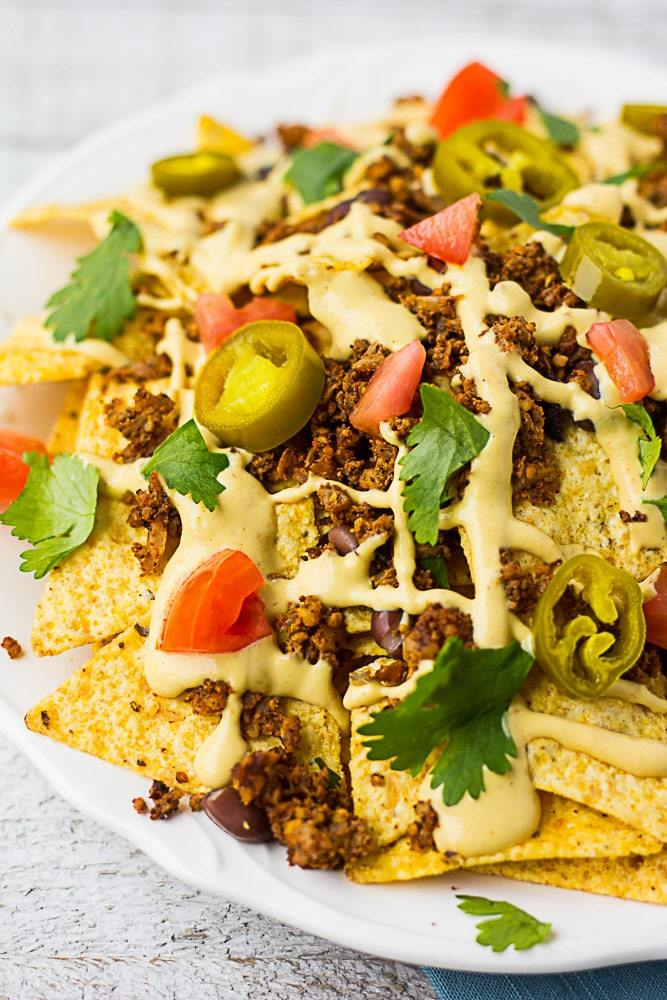 Fully Loaded Vegan Nachos by Nora Cooks Plant-Based // 10 Classic Ballpark Recipes Made Vegan