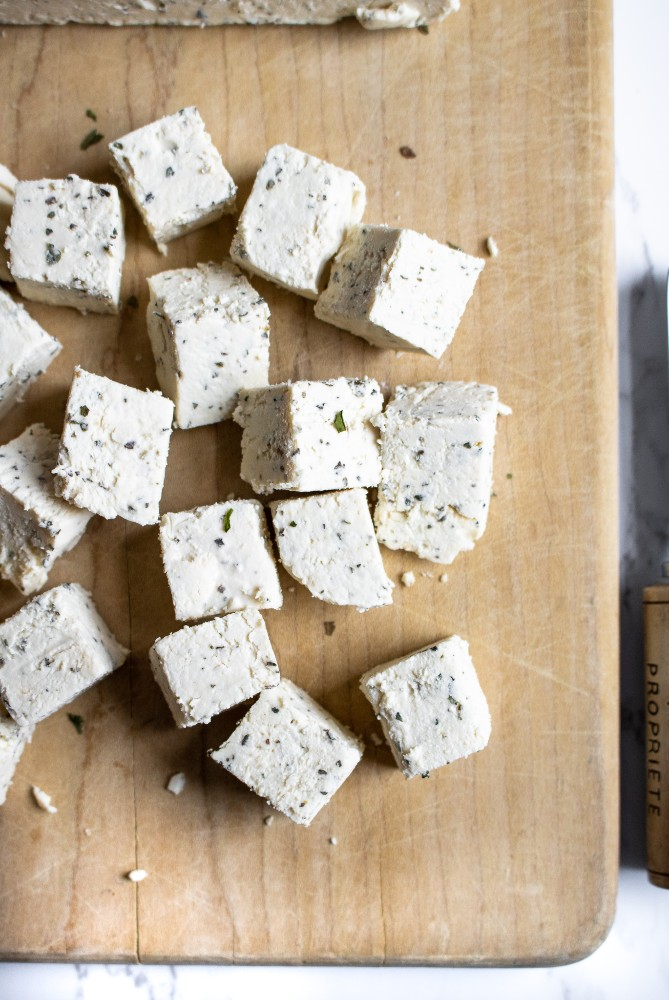 The most awesome vegan feta cheese! It's slice-able, crumbly, easy to make, and flavorful'. Great for salads, snack plates, pitas, and pastas! #vegan #vegancheese #veganfeta #tofu #dairyfree #plantbased