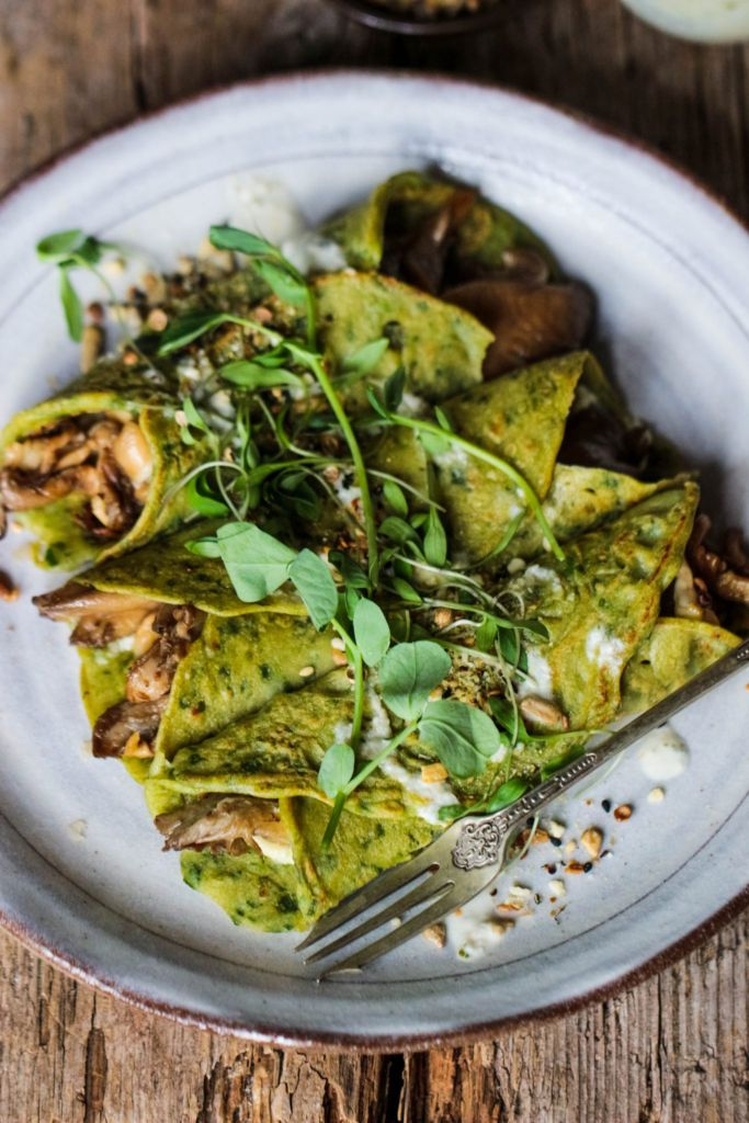 10 (Vegan) Ways to Get Your Greens That Aren't Salad or Gross: Spinach Crepes with Mushrooms, Basil Pesto, and Tahini Dressing by Rebel Recipes