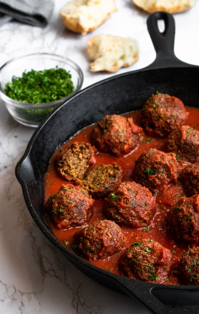 The BEST Vegan Meatballs made with TVP. They're SUPER meaty, full of spicy Italian flavor, and NOT mushy - our #vegan #meatball dreams come true! #vegetarian #veganmeatballs #plantbased #plantpowercouple // plantpowercouple.com