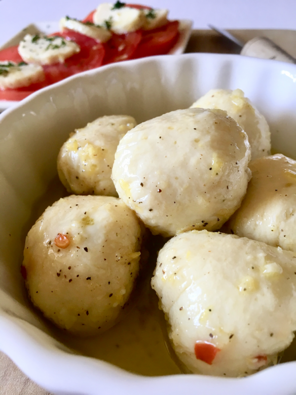 Lemon Pepper Marinated Vegan Bocconcin aka mozzarella balls. This vegan cheese recipe is so darn good! It slices, melts, and tastes great popped right into your mouth! // plantpowercouple.com