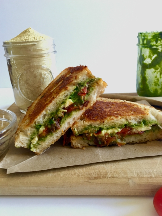 This vegan caprese grilled cheese sandwich is the epitome of summertime greatness! Flavor-packed pesto, balsamic tomato jam, and our favorite fresh vegan mozzarella all wrapped in the loving arms of two pieces of garlic bread - HELLO, HEAVEN! // Recipe: plantpowercouple.com