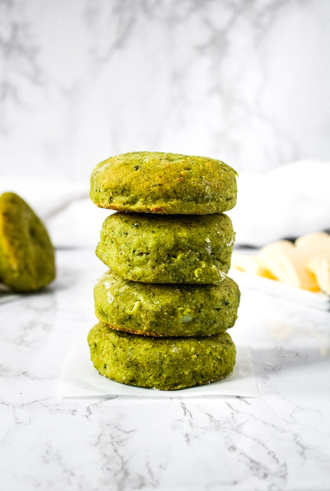These Vegan Pesto Potato Biscuits are soft, fluffy, and flavor-packed. Yeast-free biscuits are so easy to make and taste great served as a plant-based breakfast with a slather of vegan butter, smothered in dairy-free gravy, alongside a big salad for lunch, or eaten straight out of the oven! It's a great recipe to use up leftover mashed potatoes in the winter and basil from your garden hauls in the summer. You only need 8 ingredients and 45 minutes to make amazing homemade pesto biscuits!