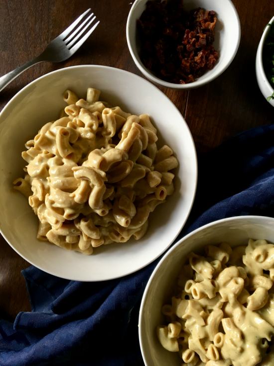 Creamy vegan roasted garlic sauce that is completely dairy-free and VEGAN! No cashew-soaking required, just roast your garlic, blend the ingredients, and pour over pasta! // Recipe from plantpowercouple.com