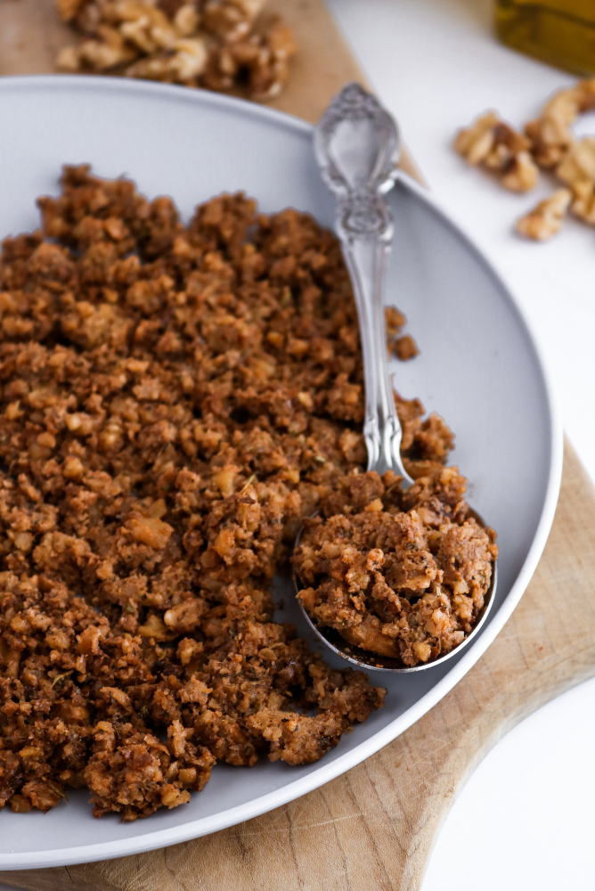 This vegan sausage-style walnut meat is a great option for topping pizzas, pasta, and even breakfast tacos! We love how easy it is to make. #vegan #walnuts #recipe #plantbased //plantpowercouple.com