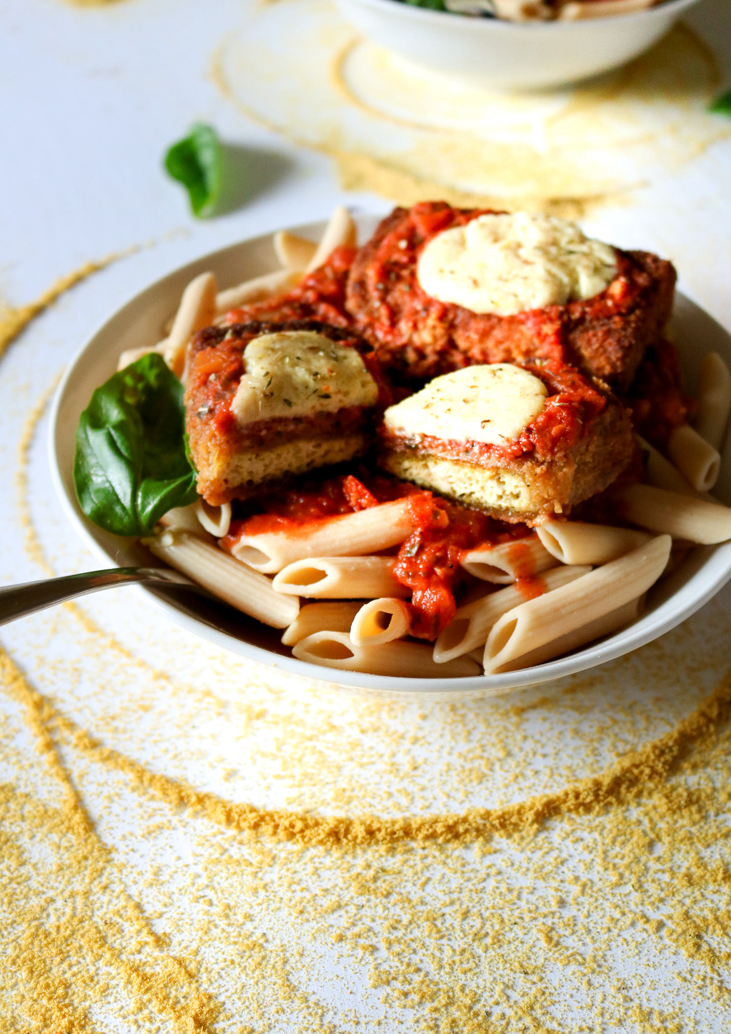 The BEST vegan chicken parmesan we've ever tasted! You won't believe these cutlets are made with tofu after you're done with them, and that peppery breading really knocks it outta the park. Gluten-free option, and the cutlets are freezer-friendly! // plantpowercouple.com