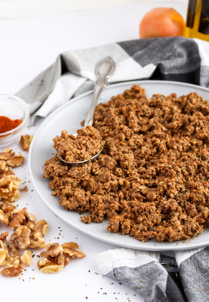 This spicy beef-style walnut meat is our go-to recipe for Taco Tuesday and beyond! It's easy to make, with only 9 ingredients and 5 minutes of active time, and the flavor is totally addictive. #vegan #walnuts #vegetarian #veganrecipes