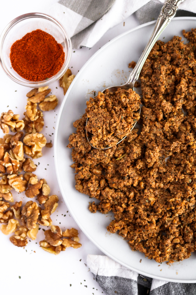 This spicy beef-style walnut meat is our go-to recipe for Taco Tuesday and beyond! It's easy to make, with only 9 ingredients and 5 minutes of active time, and the flavor is totally addictive. #vegan #walnuts #vegetarian #veganrecipes // plantpowercouple.com