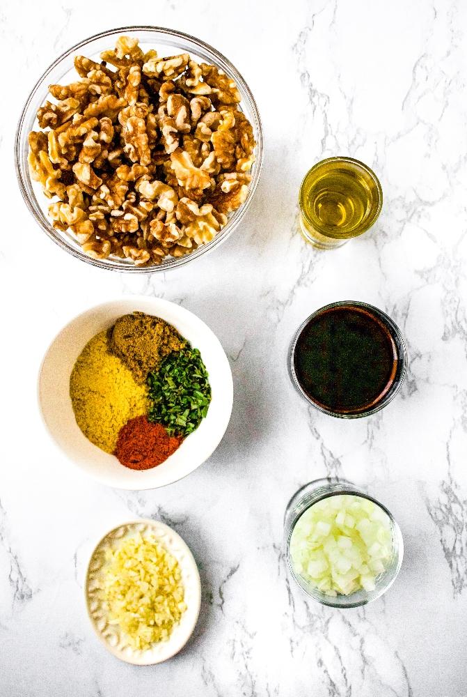 Ingredients in walnut taco meat: raw soaked walnuts, nutritional yeast, cayenne pepper, oregano, cumin, minced onion, minced garlic, soy sauce, olive oil.