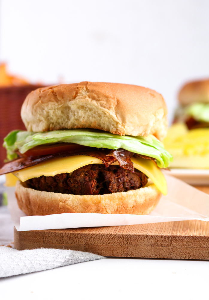 The BEST homemade vegan burgers! A perfect blend of TVP and seitan make an irresistibly meaty texture with beets for a nice but light pink color and seasoned to perfection. They're also freezer-friendly, easy to make, and so satisfying! #vegan #TVP #burger #plantbased #vegetarian // plantpowercouple.com