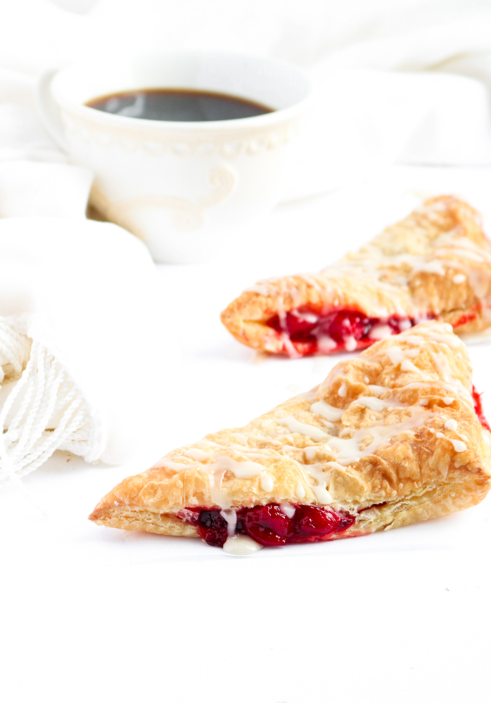 These vegan cherry turnovers are so sinfully simple and devilishly delicious! With just two ingredients, even the most beginner of cooks can have these gorgeous bakery-style beauties done and ready to eat - for breakfast OR dessert - in just under an hour. #vegan #breakfast #turnover #cherries // plantpowercouple.com