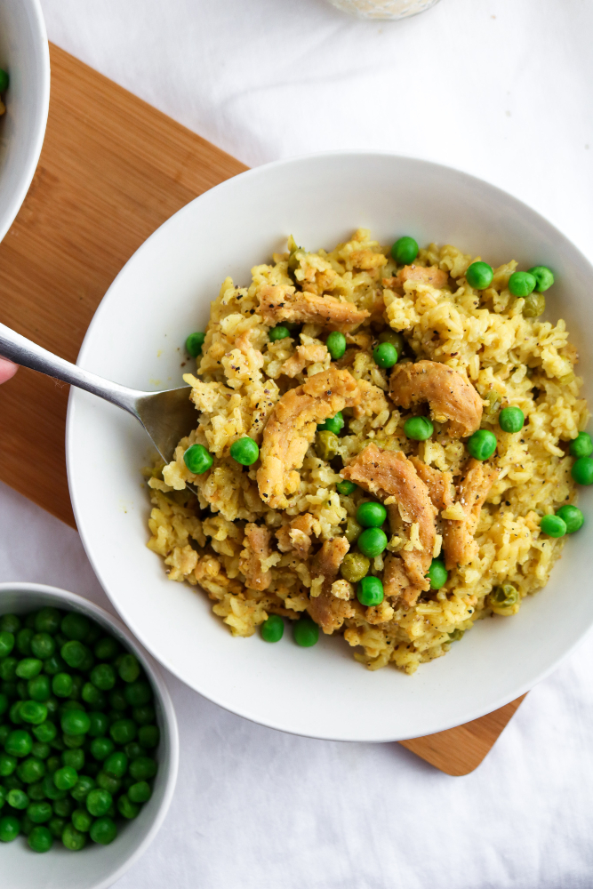 This easy slow cooker vegan chicken and rice is classic comfort food made vegan! Great for a busy weeknight or meal prep session, it's also healthy, gluten-free, and can easily be made oil-free. #vegan #crockpot #slowcooker #rice #soycurls // plantpowercouple.com