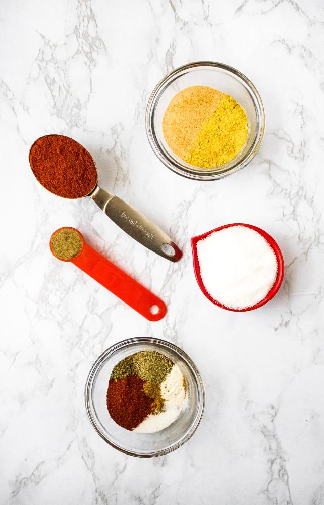 Copycat Red Robin Seasoning: paprika, sea salt, celery salt, nutritional yeast, chili powder, black pepper, dried basil, onion powder, ground cumin.