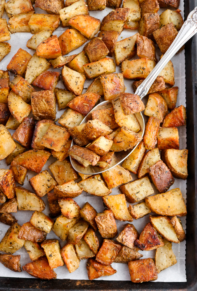 Every good cook needs a solid roasted potato recipe in their arsenal, and this is ours! It's made with only six simple ingredients and comes out perfectly crispy + flavorful every. single. time. #vegan #potatoes #veganrecipes #glutenfree #plantbased // plantpowercouple.com