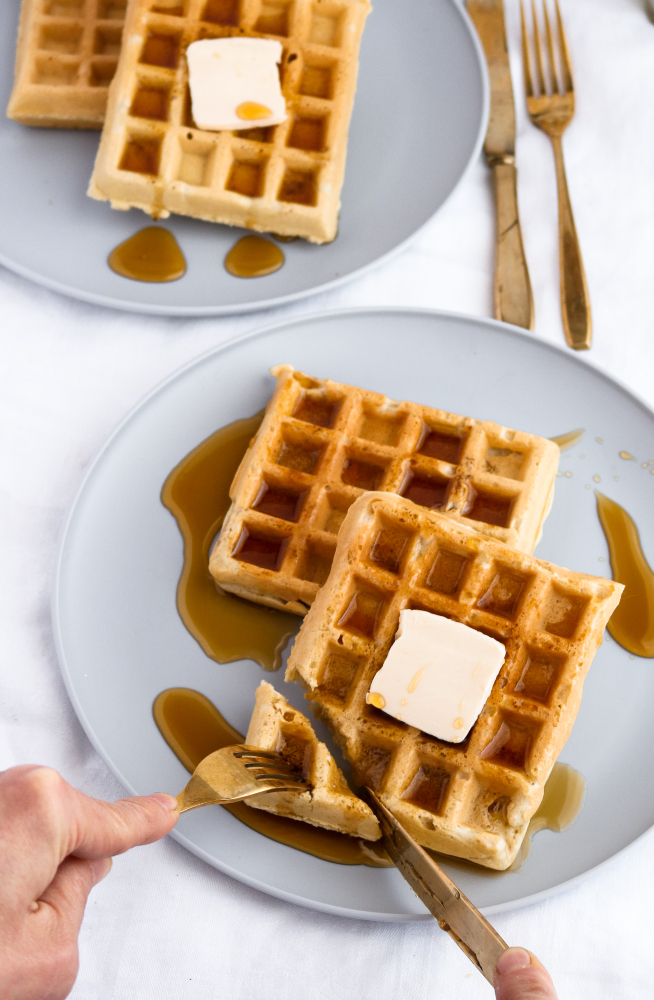 Easy, ten-ingredient, freezer-friendly and toaster-friendly homemade vegan waffles. Simple enough for the beginner cook to dazzle and the perfect addition to a Sunday brunch… or a Thursday dinner! #vegan #waffles #dairyfree #breakfast // plantpowercouple.com