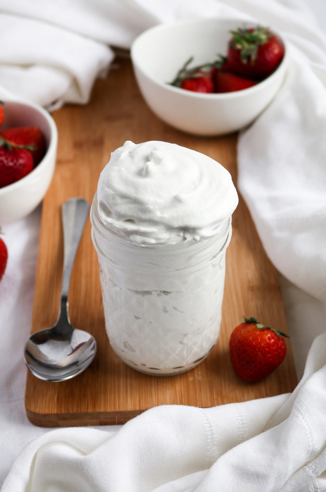 This 5-ingredient vegan whipped cream is easy to make, stable AF, and freezer-friendly. It's a fantastic addition to sundaes, pancakes, or a big bowl of strawberries - the PERFECT summer treat! #vegan #dairyfree #dessert #recipe // plantpowercouple.com