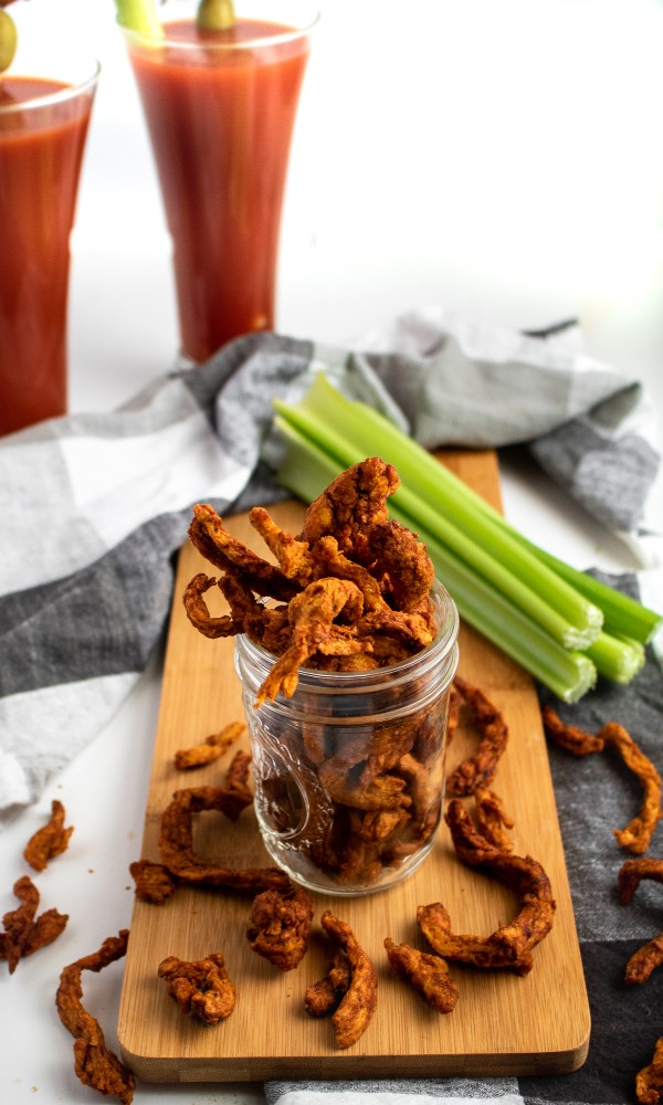This meaty vegan jerky is made in the air fryer and full of that classic Bloody Mary cocktail flavor. The perfect snack to enjoy with a cold beer! #vegan #plantbased #jerky #recipe // plantpowercouple.com