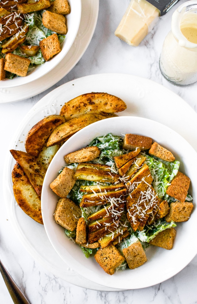 These Lemon Pepper Tofu Cutlets are the perfect meal prep staple! Frozen + thawed tofu is sliced and soaked in a bath of zesty lemon pepper flavor. Then, they're slow-baked to achieve that perfect meaty texture. Slice 'em up for salads, use them for sandwiches, or serve 'em over a mountain of rice for a filling and easy vegan dinner!