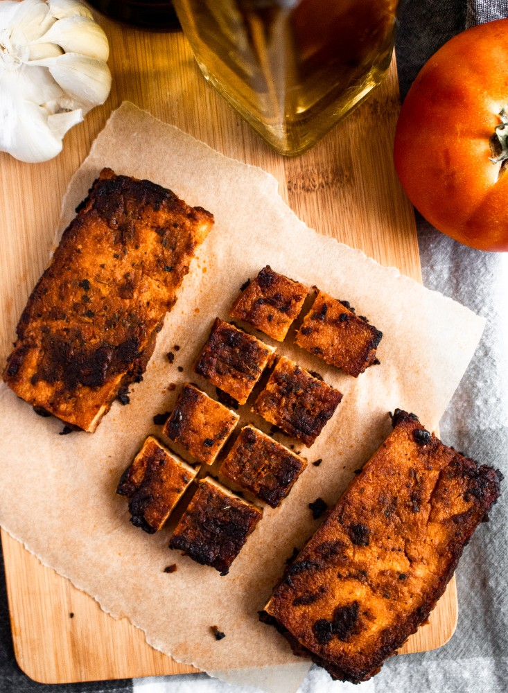 These Balsamic Tomato Tofu Cutlets are crazy meaty, full of balsamic-tomato-garlic-y flavor thanks to a dynamite tofu marinade, and very easy to make! They are meal-prep and freezer-friendly and pair beautifully with pasta, on a sandwich, or straight off the pan. #vegan #tofu #balsamic #plantbased #veganrecipes #tofurecipes // plantpowercouple.com