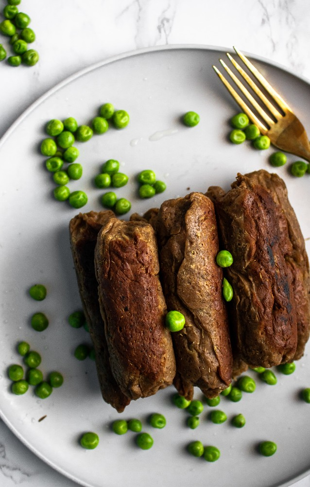 THE most meaty, mouth-watering, and memorable seitan sausages of all time! With only 10 ingredients and 1 hour, you can make perfect vegan sausages right in your own kitchen. #vegan #seitan #dinner #plantbased // plantpowercouple.com