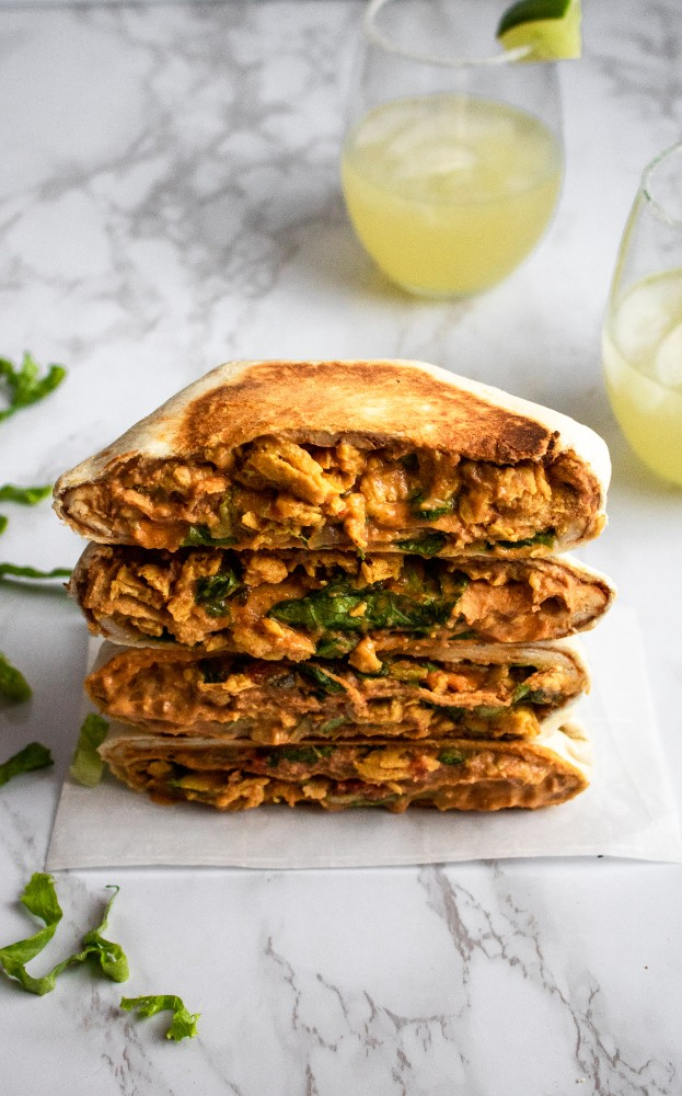 This vegan crunchwrap is delicious, easy, and just plain FUN. It makes an awesome vegan dinner or lunch recipe that can be prepared ahead of time and totally customized to your tastes. #vegan #crunchwrap #plantbased #plantpowercouple // plantpowercouple.com