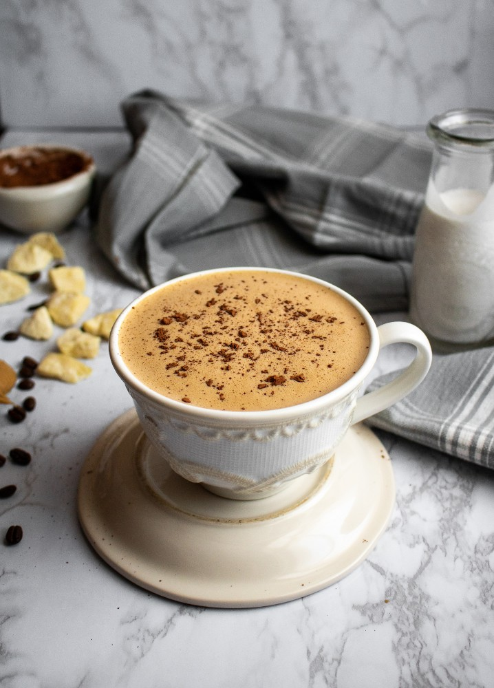 This Vegan Peanut Butter Cup Blender Latte is like a breakfast smoothie meets warm and cozy winter drink meets your caffeine addiction. 6 ingredients, 10 minutes, perfect vegan breakfast recipe for busy mornings! #vegan #dairyfree #veganrecipes #blenderlatte // plantpowercouple.com