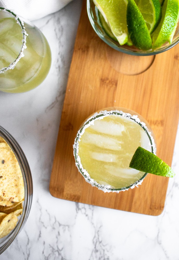 This is our go-to homemade margarita recipe! It's simple, using only 4 ingredients and perfect for date-night-in or Taco Tuesday! It's easy to make and the best combination of sour, sweet, and salty. #vegancocktail #cocktail #margarita #lime #tequila #vegancocktailrecipe #homemade #tacotuesday