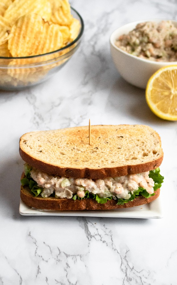 This vegan tuna salad is a simple recipe, using white beans and a few other common ingredients you probably have around the house + one *magic* ingredient to create the flavor + texture of a classic tuna sandwich! #vegan #tuna #vegantuna #lunch #veganlunch #beans #plantbased #navybeans #whitebeans