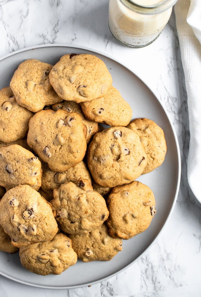 These are the BEST vegan chocolate chip cookies. The recipe is easy to make with simple ingredients, using applesauce instead of eggs for a healthy swap. These chewy vegan cookies taste just like the ones you grew up making! #vegan #vegancookies #vegandessert #vegandessertrecipe #chocolatechipcookies #eggfree #dairyfree #chocolate #veganchocolate #vegan #veganbaking #holidaybaking