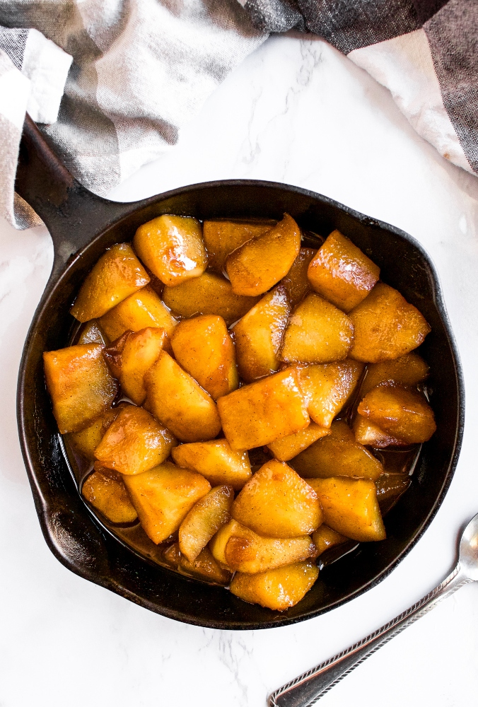 These vegan sauteed cinnamon apples are made on the stovetop and the best topping for pancakes, waffles, or ice cream. These dairy-free sauteed apples are gluten-free, include a low-sugar option, and taste like warm apple pie filling with just 5 simple ingredients. Our favorite way to use up excess apples!