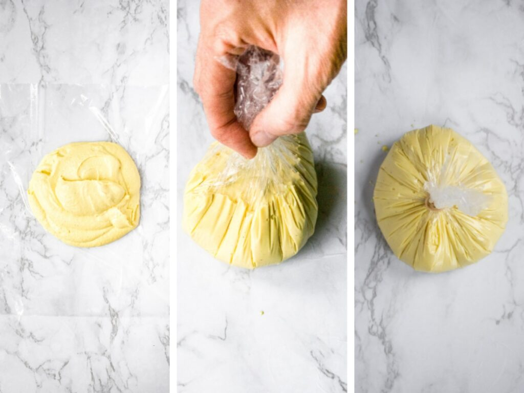 The three steps to shaping a vegan cheese ball: plop the dairy free cheese mixture on a sheet of plastic wrap, pull up on the edges of the wrap, and tie it with a rubber band to form a ball.