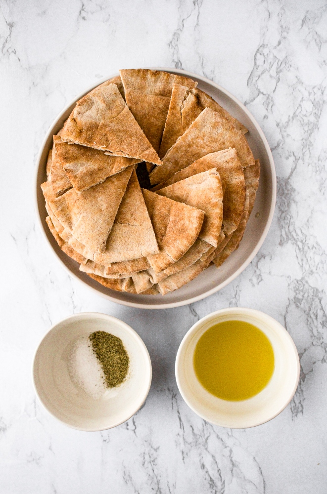 Make your own pita chips in the air fryer with just 4 ingredients and 20 minutes of your time! Perfect for snacking or dipping in hummus.