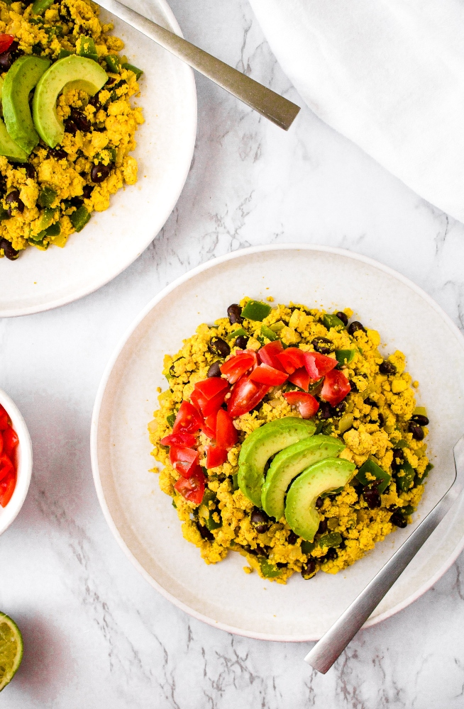 This vegan tofu scramble recipe infused with Southwest flavors is a healthy and delicious plant-based breakfast option! It's an egg-free breakfast scramble made with black salt for that unique eggy flavor as well as a wonderful array of common household spices. We love to serve this as a breakfast platter or burrito and even sometimes make a big batch to have breakfast for dinner!