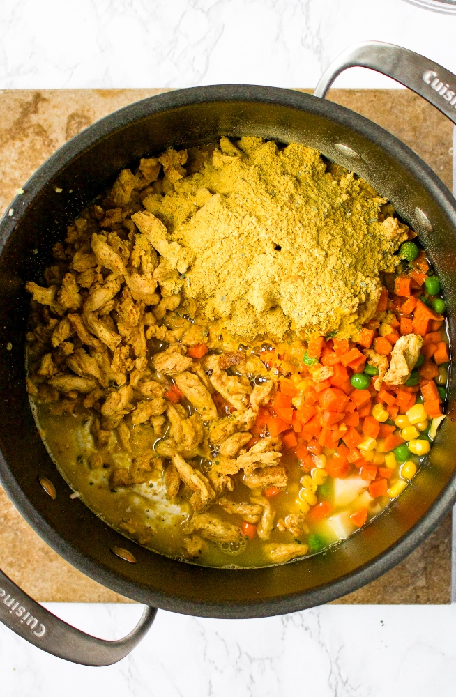 This vegan chicken stew makes the perfect cozy winter dinner. This creamy vegetable stew with meaty soy curls is easy to make using common ingredients, methods, and hidden vegetables like cauliflower! This vegan stew recipe is freezer-friendly and the perfect plant-based meal prep recipe. It's also gluten-free, dairy-free, and easily made oil-free.