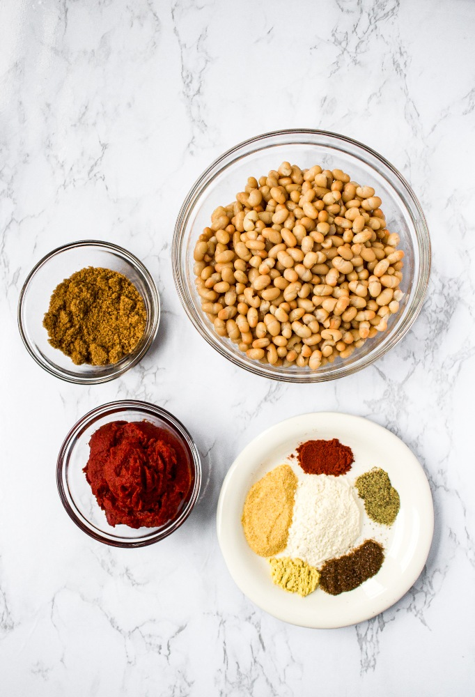 Healthy Vegan Baked Beans Ingredients: white beans, tomato paste, brown sugar, and spices.