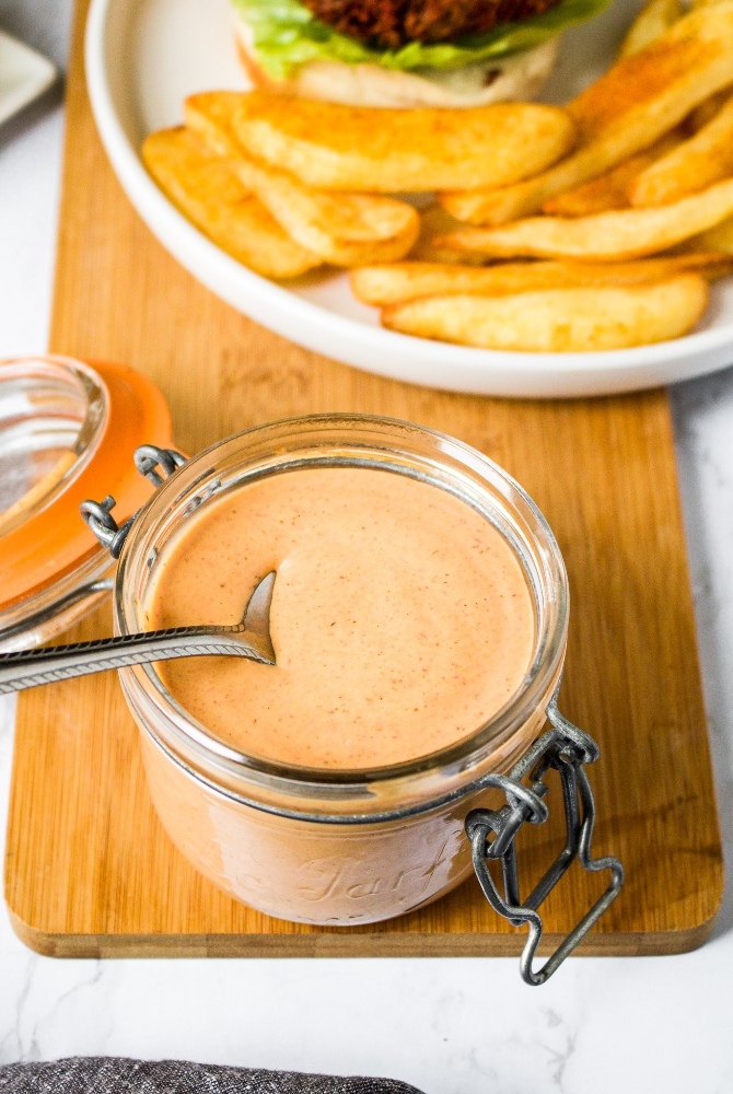 This is the BEST vegan burger sauce recipe! It's tangy and flavorful with just a hint of spice and a touch of sweet. It's like a vegan version of the Big Mac sauce! Perfect as a vegan burger condiment or sandwich spread; great for dipping fries or for making a vegan burger salad! It's easy to make with simple ingredients you probably have in your house right now.