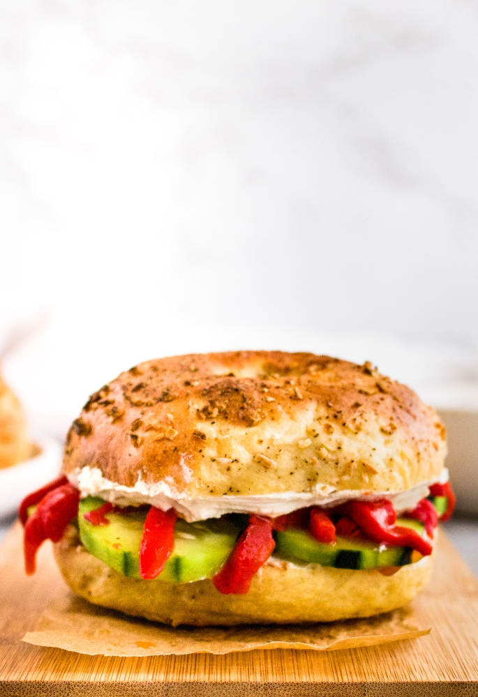 This homemade vegan onion bagel recipe is just as delicious as it is fun to make! Peppery onion plant-based bagels are fantastic served as a vegan bagel sandwich for breakfast with tofu scramble or lunch with dairy-free cream cheese and all the fresh vegetables. In this post, we'll walk you through how to make your own egg-free bagels at home with step by step photos and instructions!